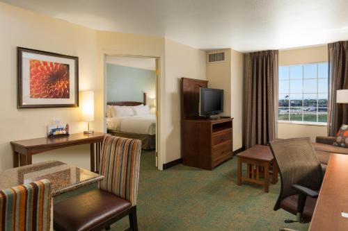 A television and/or entertainment center at Staybridge Suites Sacramento-Folsom, an IHG hotel