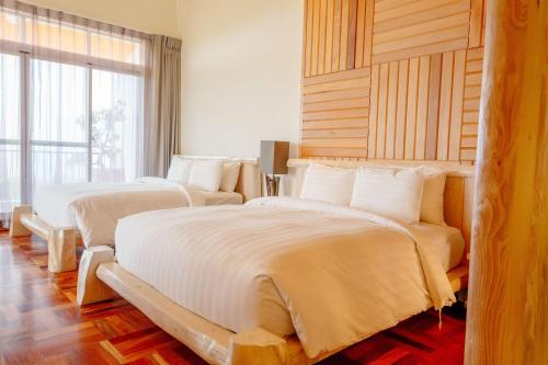 A bed or beds in a room at Bay Forest Boutique B&B