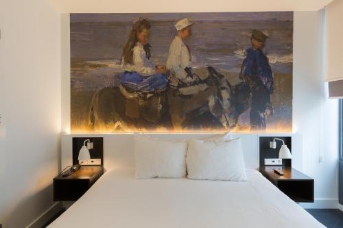 Een bed of bedden in een kamer bij B-aparthotel Kennedy