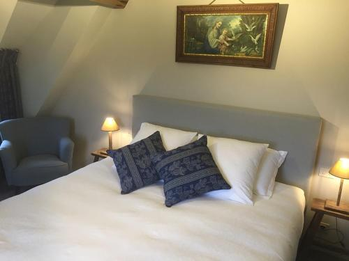 Ein Bett oder Betten in einem Zimmer der Unterkunft de Gasterie