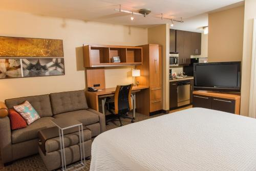 A television and/or entertainment center at TownePlace Suites by Marriott Erie