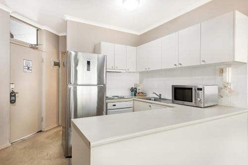 A kitchen or kitchenette at Punt Road Apartment Hotel