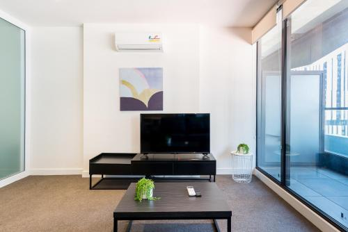 A television and/or entertainment center at The Jasmine Holiday Home in Melbourne