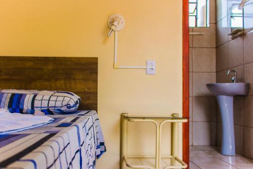 A bathroom at Cavalo Branco Hotel