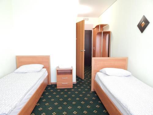 Кровать или кровати в номере Отель Монблан