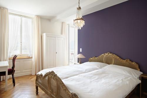 Ein Bett oder Betten in einem Zimmer der Unterkunft Hotel Terrasse am See