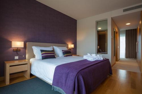 Uma cama ou camas num quarto em Madre De Água Hotel Rural de Charme