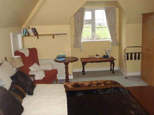 A bed or beds in a room at Glendine Irish Home B&B