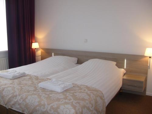 Een bed of bedden in een kamer bij Hotel Norg
