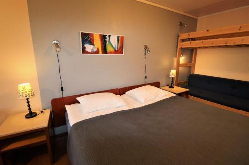 Säng eller sängar i ett rum på Lyckans Vandringshem