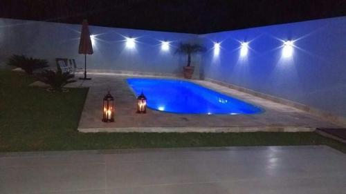 The swimming pool at or near Casa p/ família - Caravelas Pinta