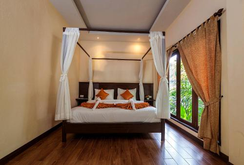 A bed or beds in a room at Lanta Klong Nin Beach Resort