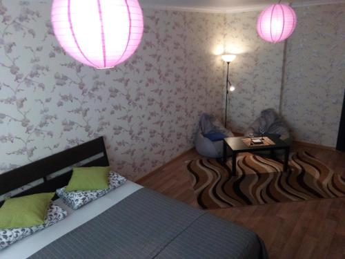 A bed or beds in a room at Apartments ''Cube'' - Dimitrova 110 G