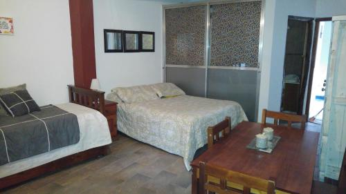 A bed or beds in a room at Apartment Maipu II