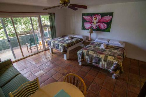 A bed or beds in a room at Backpackers Vacation Inn and Plantation Village