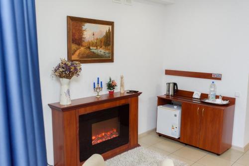 A kitchen or kitchenette at M&M Aparthotel