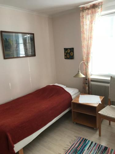 A bed or beds in a room at Övergrans Jordbruk