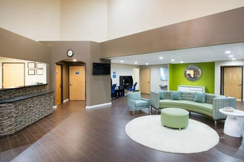The lobby or reception area at Days Inn & Suites by Wyndham Cherry Hill - Philadelphia