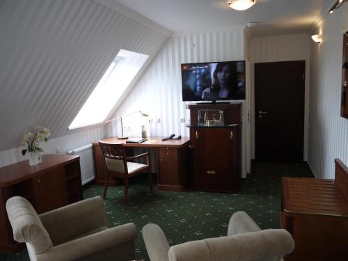 A television and/or entertainment center at Landhotel Schwarzer Adler