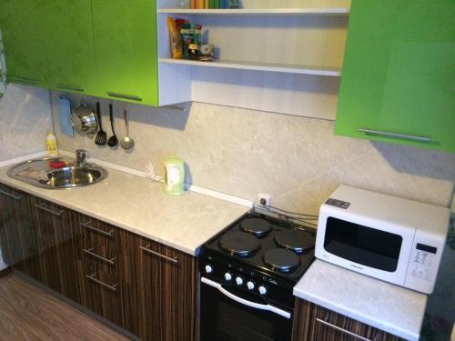 A kitchen or kitchenette at Апартамент