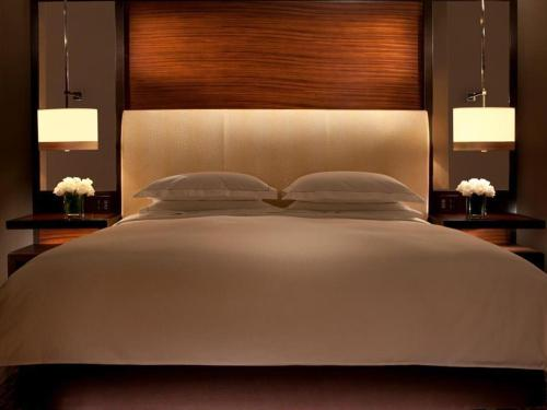 A bed or beds in a room at Hilton McLean Tysons Corner