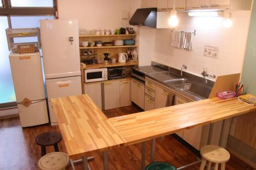 A kitchen or kitchenette at J-Hoppers Osaka Guesthouse