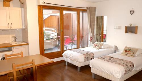 Un ou plusieurs lits dans un hébergement de l'établissement Le Grand Chalet - Le Studio