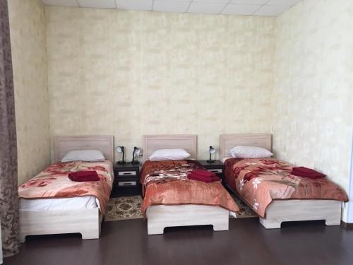 A bed or beds in a room at Guest House na Bannom 5