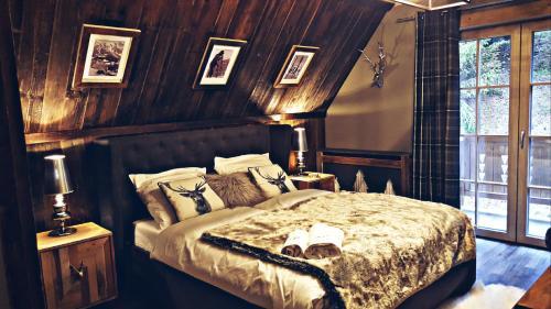 A bed or beds in a room at Tatrzański biegun