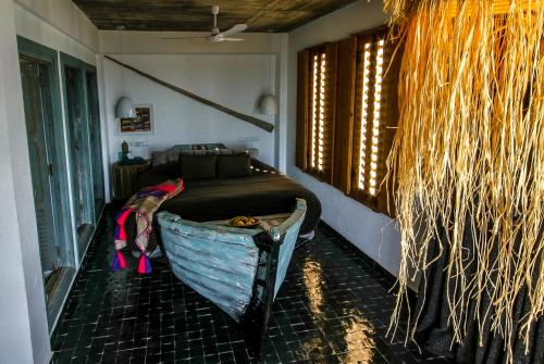 A bed or beds in a room at Munga Guesthouse