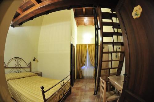 A bed or beds in a room at Azienda Agrituristica La Valle del Sambuco