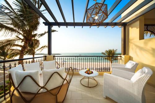 A balcony or terrace at Hilton Ras Al Khaimah Beach Resort