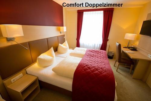 Ein Bett oder Betten in einem Zimmer der Unterkunft Hotel & Restaurant Wiggers