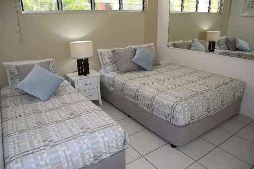 A bed or beds in a room at Lagoon Beachfront Lodge 005 on Hamilton Island by HamoRent