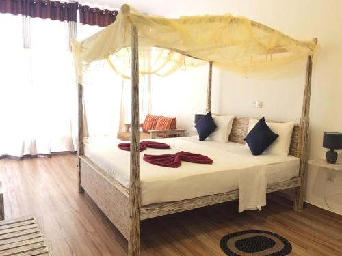 A bed or beds in a room at Yula Beach