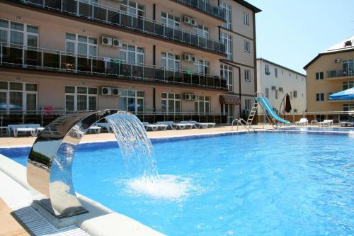 Бассейн в Гранд Прибой Отель или поблизости