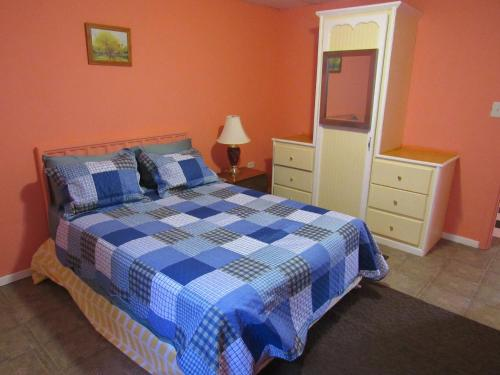 A bed or beds in a room at Calabash Mountain Villa
