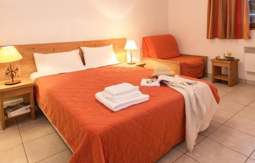 Un ou plusieurs lits dans un hébergement de l'établissement Résidence Odalys Les Chalets d'Evian