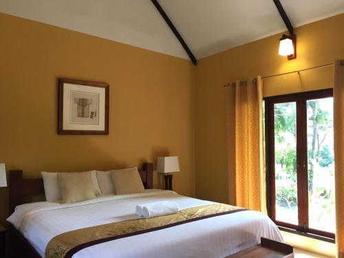 Un ou plusieurs lits dans un hébergement de l'établissement Baan Thai House