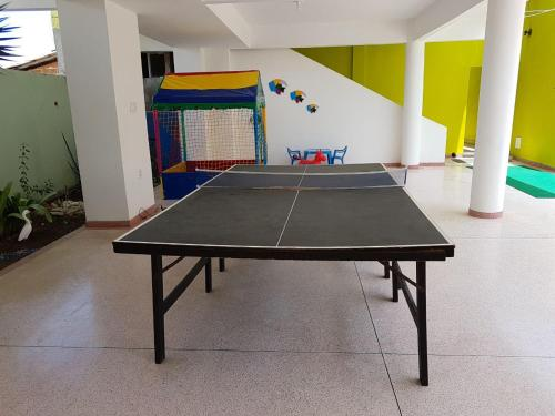 Ping-pong facilities at Hotel Pousada Oasis or nearby