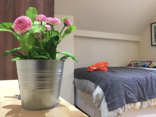 A bed or beds in a room at 247 London Hostel