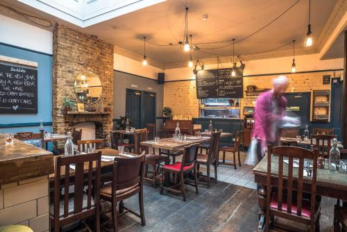 A restaurant or other place to eat at Old Ship Inn Hackney