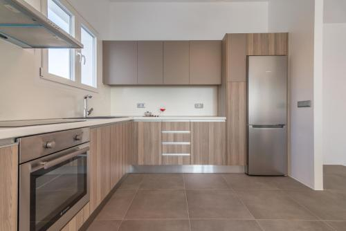 A kitchen or kitchenette at Milos Waves Luxury Apartments