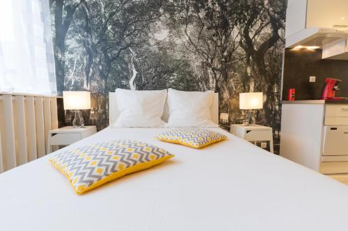 A bed or beds in a room at Chambery Appart Hotels