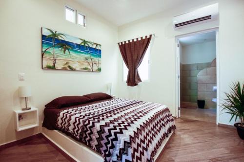 Cama o camas de una habitación en Casa Mi Playa