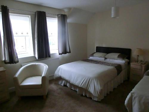 A bed or beds in a room at The Gungate