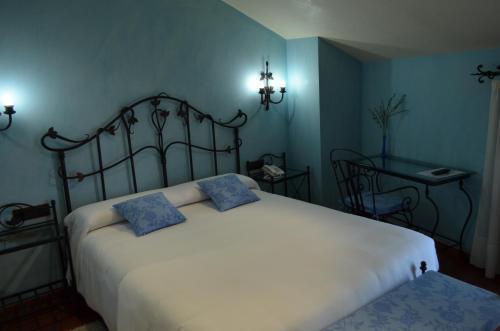 Cama o camas de una habitación en Hotel Apartamento Marouco