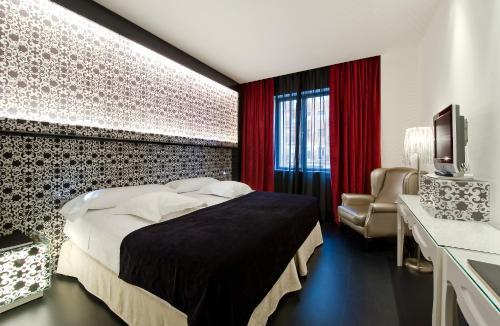 A bed or beds in a room at Vincci Vía - 66