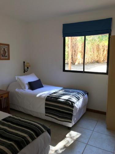 Cama o camas de una habitación en Hotel El Galpon de Elqui