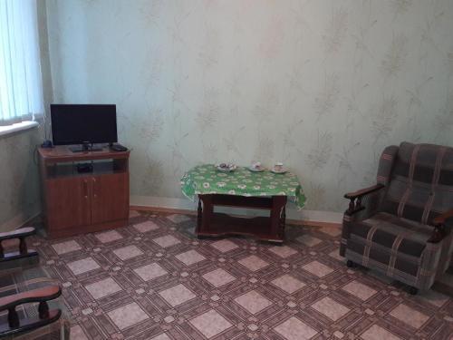 Телевизор и/или развлекательный центр в Hotel Druzhba
